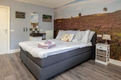 Een van de slaapkamers van Vakantievilla Viva la Veluwe